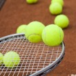 Постер, плакат: Tennis racket with tennis balls
