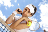 Woman standing near tennis grid — Stock Photo