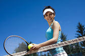 Woman holding tennis ball — Stock Photo