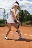 Tennis player ready for a serve — Stock Photo