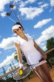 Mujer jugando al tenis — Foto de Stock