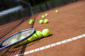 Tennis balls lying in row — Stock Photo