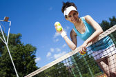 Woman holding tennis balls — Stock Photo