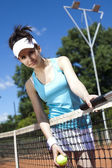 Woman holding tennis ball — Stock Photo
