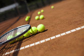 Tennis racket with tennis balls — Stock Photo