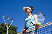 Woman near tennis net — Stock Photo