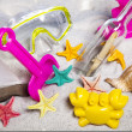 Plastic toys on beach — Stock Photo #49137303