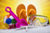 Sand beach and flip flops — Stock Photo
