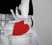 Teenager holding a heart — Stock Photo