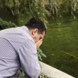 Stressed man in the park — Stock Photo
