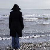 Lonely person on a beach — Stock Photo