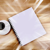 White cup and white page — Stock Photo