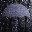 Water drops and an umbrella — Stock Photo