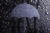 Water drops and an umbrella — Stockfoto