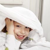Happy child in the bed — Stock Photo