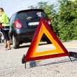 Broken down car with red warning triangle — Stock Photo #12191545