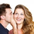 Royalty-Free Stock Photo: Young man whispering a secret