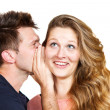 Young man whispering a secret — Stock Photo
