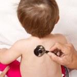 Infant with stethoscope — Stock Photo