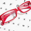 Eyesight test chart with glasses - Stock Photo