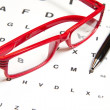 Stock Photo: Eyesight test chart with glasses