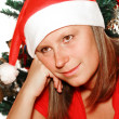 Stock Photo: Beautiful girl with christmas tree