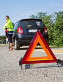 Broken down car with red warning triangle — Stock Photo