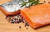 Fresh salmon fillet on wooden board — Stock Photo