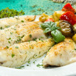 Tasty healthy fish fillet with vegetables — Stock Photo #13891652