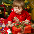 Stock Photo: Baby at Christmas tree