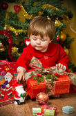 Baby at Christmas tree — Stock Photo