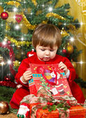 Young mother with baby at Christmas tree — Stock Photo