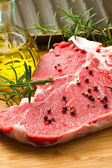 Raw T-bone with rosemary — Stock Photo