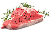 Raw T-bone with rosemary — Stok fotoğraf