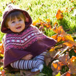 Baby with autumn leaf — Stock Photo