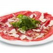 Carpaccio of beef on arugula — Stock Photo