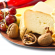 Red wine with  cheese selection over white — Stock Photo