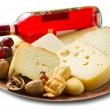 Red wine with cheese selection over white — Stockfoto
