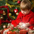 Baby play with present box at Christmas tree — Stock Photo #15727451