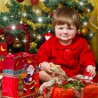 Baby play with present box at Christmas tree — Stock Photo #15727547