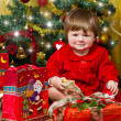 Baby play with present box at Christmas tree — Stock Photo