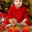 Baby play with present box at Christmas tree — Stock Photo #15727553
