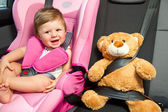 Baby in a safety car seat. Safety and security — Zdjęcie stockowe