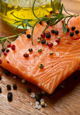Fresh salmon fillet on wooden board — 图库照片