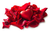 Red rose petals with heart — Stock Photo