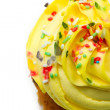 Stock Photo: Cupcake with yellow icing