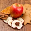 Fresh apple with biscuit,cinnamon and fruit dried — Stock Photo