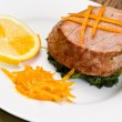 Fried tuna fillet with fresh orange ,orange sauce and spinach — Stock Photo #18145469