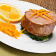 Fried tuna fillet with fresh orange ,orange sauce and spinach — Stock Photo #18145485