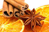 Cinnamon sticks, star anise and dried orange cuts — Stock Photo